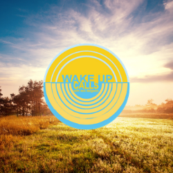 Sunrise over a green grassy field with tree silhouette in the background and Wake Up Calls logo