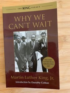 The book Why we cant wait by Martin Luther King on a wooden background